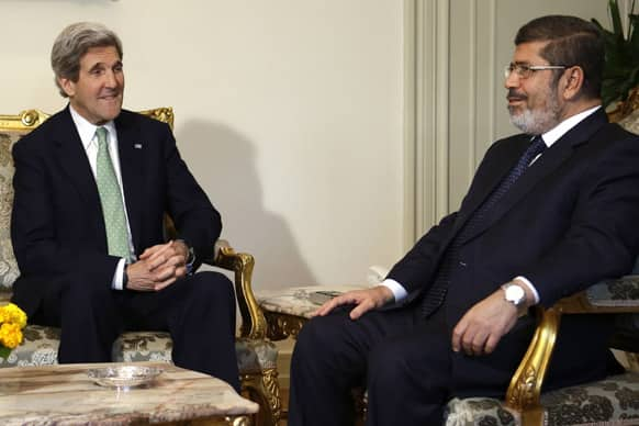 US Secretary of State John Kerry, left, meets with Egyptian President Mohamed Morsi at the Presidential Palace in Cairo, Egypt.