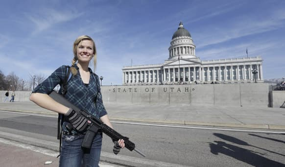 Gun rights activist Darci Lund, 20, carries her rifle during a rally in support of the 2nd Amendment at the Utah State Capitol in Salt Lake City.