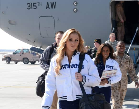 Dallas Cowboys Cheerleaders Cassie Trammell (left) and Jackie Bob, along with Peyton Manning, Curt Schilling, Austin Collie and Steven Jackson arrive at Bagram Airfield, Afghanistan, to entertain the troops with a USO tour.