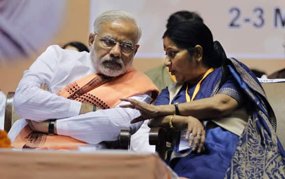 Narendra Modi and Sushma Swaraj speak during a meeting in New Delhi. The two-day long national council meeting of the BJP began Saturday.