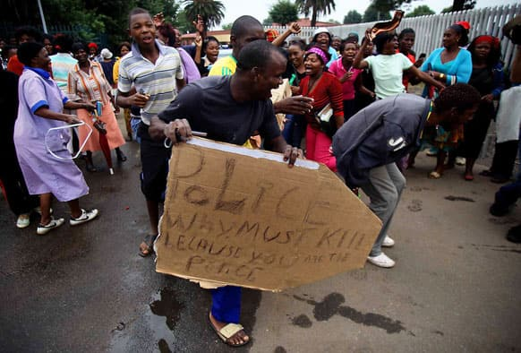 Residents protest the death of Mozambican taxi driver Mido Macia outside a local police station, in Daveyton, near Johannesburg, South Africa.