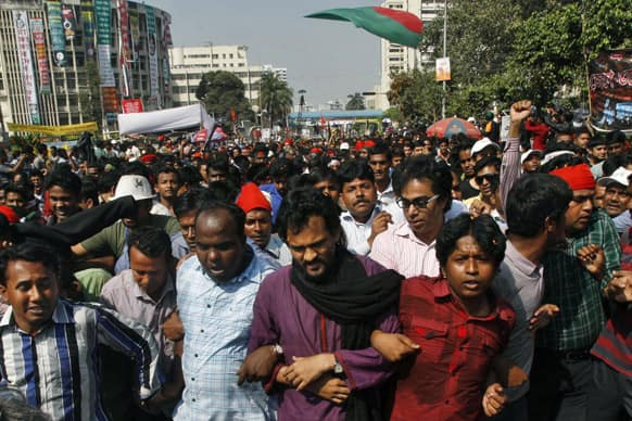 Bangladeshi youth march through the streets as they celebrate the death sentence awarded to Jamaat-e-Islami leader Delwar Hossain Sayedee in Dhaka, Bangladesh.