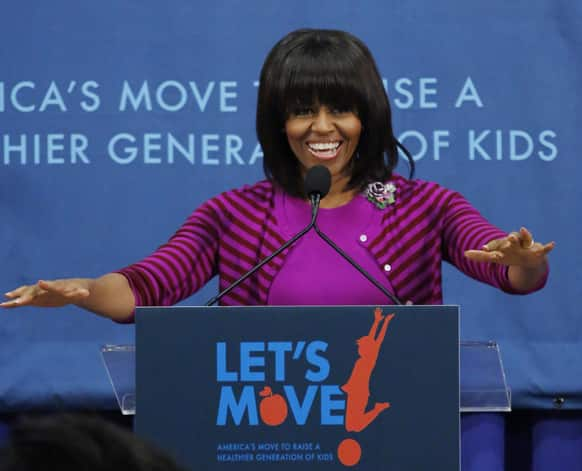 First lady Michelle Obama motions before speaking at a