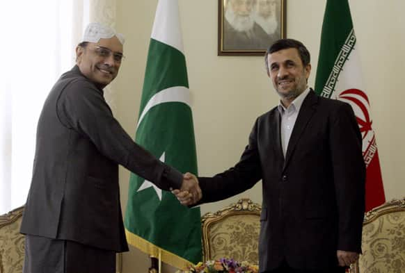 Iranian President Mahmoud Ahmadinejad and his Pakistani counterpart, Asif Ali Zardari, shake hands for photographers at the start of their meeting in Tehran, Iran.