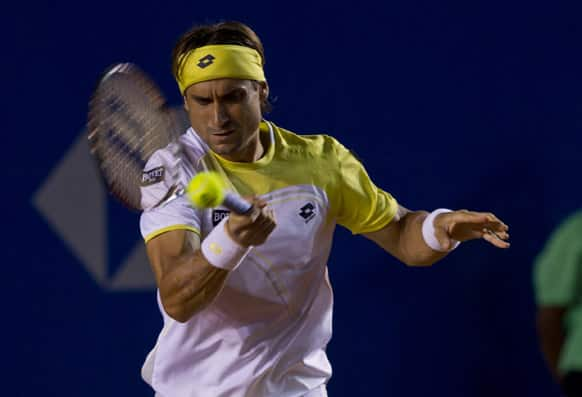 Spanish´s David Ferrer returns the balll to Croatia`s Antonio Veic during the Acapulco Tennis Open in the Pacific resort in Acapulco.