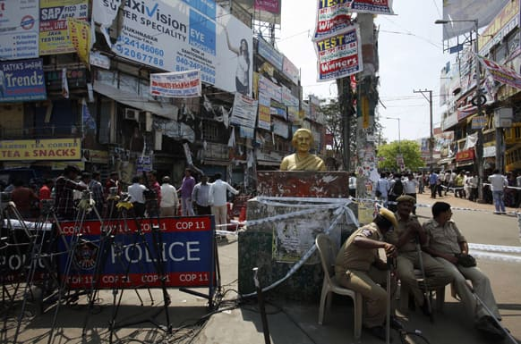 Police guard the site of one of the two bomb blasts in Hyderabad.