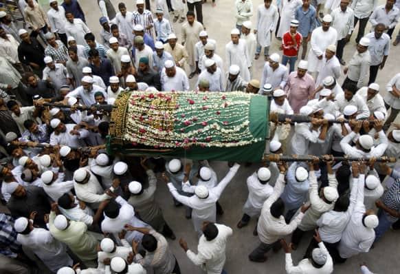 Relatives and others carry the coffin of Aijaz Ahmed, killed in Thursday's explosion, during his funeral in Hyderabad.