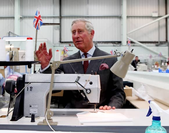Britain`s Prince Charles tries his hand at shirt making during a tour of the Shirt Manufacturing Division of Turnbull & Asser in Gloucestershire, England, to commemorate the tenth anniversary of the factory.