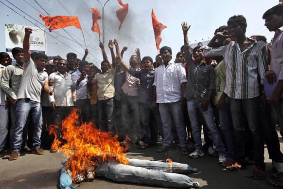 Activists of Akhil Bharatiya Vidyarthi Parishad (ABVP) shout slogans near an effigy representing the terrorist group