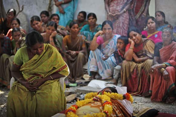 A woman, mourns by the body of her daughter Swapna Reddy, killed in Thursday's explosion, at their house in Hyderabad.