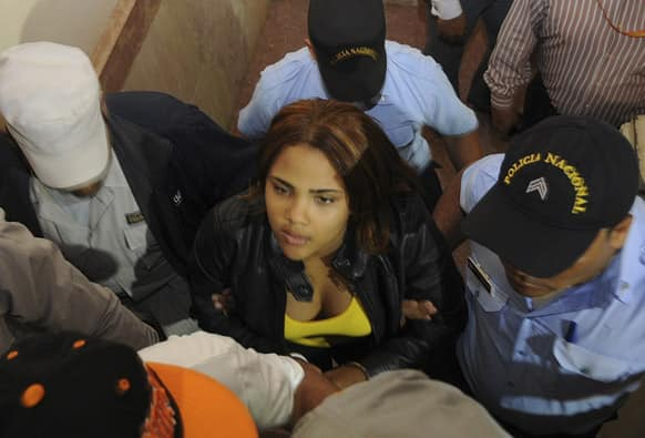 Dominican Republic`s singer Martha Heredia is escorted handcuffed into the prosecutor`s office in Santiago, Dominican Republic. Heredia, a winner of the TV talent show