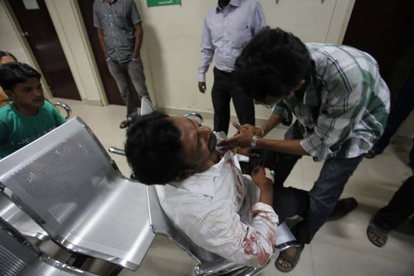 An injured man is attended to at a hospital after a bomb blast in Hyderabad.