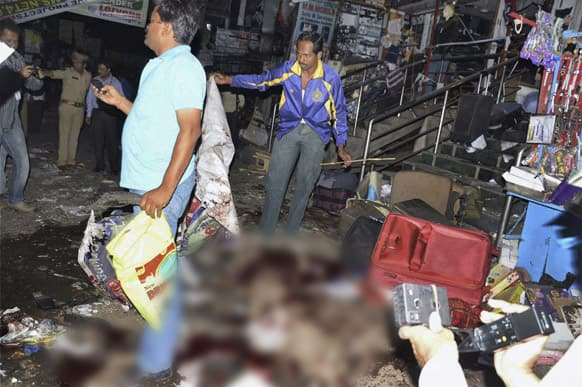 The scene of a blast at Dilsukhnagar in Hyderabad. At least ten people were killed Thursday in a pair of explosions in crowded areas of the southern Indian city of Hyderabad, police said. More were feared dead and injured.