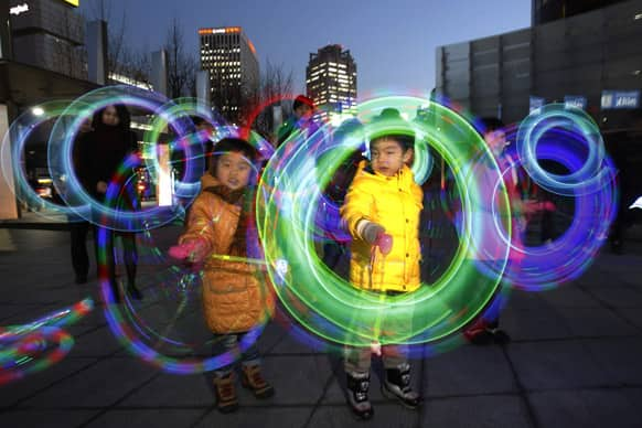 South Korean children twirl colorful light-emitting toys in celebration of upcoming first full moon of lunar calendar in Seoul.