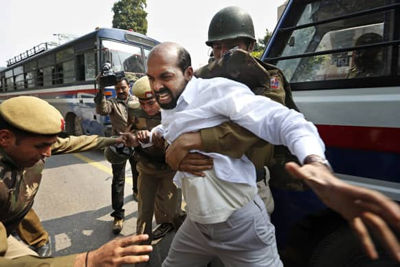 A left-wing party activist is detained after several of them reached the Parliament to protest against Rajya Sabha Deputy Chairman P. J. Kurien, who has been charged in a 1996 rape case, on the first day of the budget session in New Delhi.