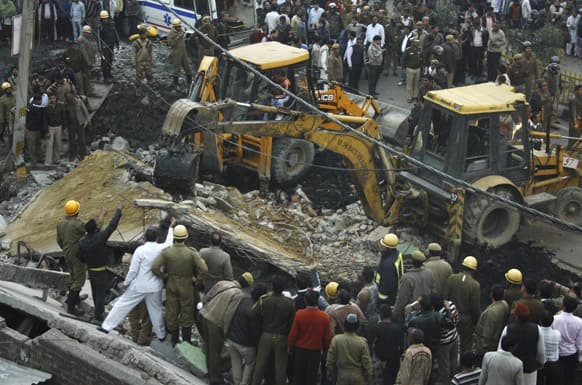 Rescuers perform search operations after a two storey building collapsed at the Tahirpur area in New Delhi. According to local news reports two persons were killed in the incident. The cause of the collapse is not yet known.