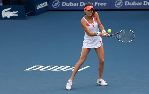 Agnieszka Radwanska of Poland returns to Yulia Putinseva of Kazakhstan during the third day of Dubai Duty Free Tennis Championships.
