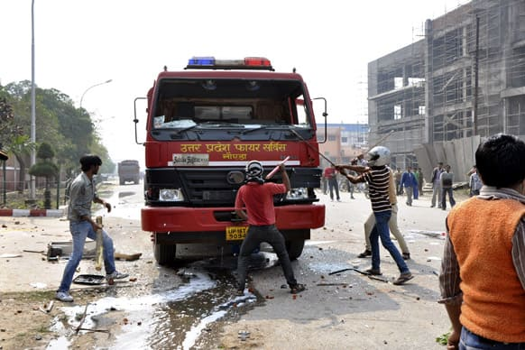 People vandalize a firetruck on the first day of a two day strike in Noida.