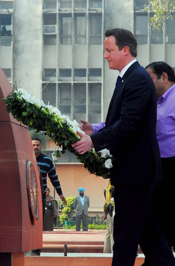 British Prime Minister David Cameron lays a wreath at the site of a notorious 1919 massacre of hundreds of Indians by British colonial forces, in Amritsar.