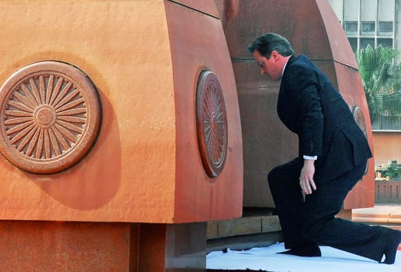 British Prime Minister David Cameron pays his respects at the site of a notorious 1919 massacre of hundreds of Indians by British colonial forces, in Amritsar.