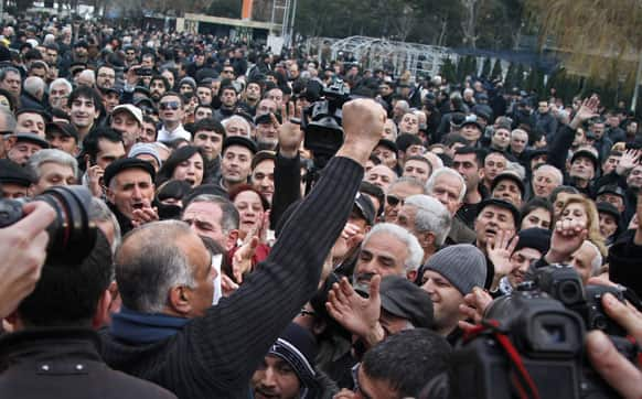 Presidential candidate Raffi Hovanessian, front, gestures at a rally in Yerevan, Armenia.