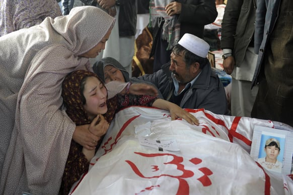 A Pakistani woman is comforted by other relatives while grieving over the body of her brother Mohammed Ali, who was killed in Saturday`s bombing, in Quetta, Pakistan.
