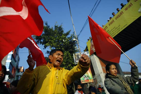 Members of the splinter faction of the Unified Communist Party of Nepal Maoist shout slogans during a general strike called by the party against the decision to form an interim government led by the Supreme Court chief justice in Katmandu.