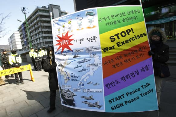 South Korean protesters carry a banner during a rally demanding a peaceful resolution to the North Korean nuclear crisis near the U.S. Embassy in Seoul.