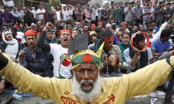 Bangladeshi people shout slogans against a nationwide general strike called by the country's largest Islamic party in Dhaka.