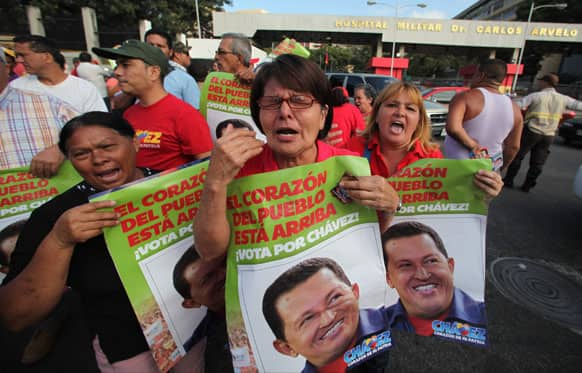 Supporters of Venezuela`s President Hugo Chavez celebrate his return to the country outside the military hospital in Caracas, Venezuela.