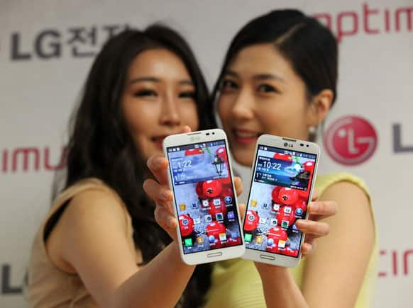 Models pose with LG Electronics` new smartphone Optimus G Pro during a press conference in Seoul, South Korea.