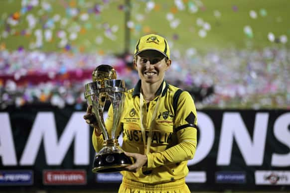 Australia`s captian Jodie Fields poses with the trophy after the team won the ICC Women`s cricket World Cup in Mumbai.