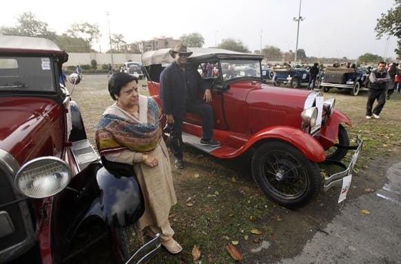 Owners pose with their vintage cars at the Statesman Vintage and Classic Car Rally in New Delhi.