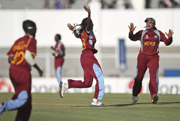 West Indies` players celebrate the dismissal of Australia`s Sarah Coyte, unseen, during the final match of the ICC Women`s World Cup cricket in Mumbai.