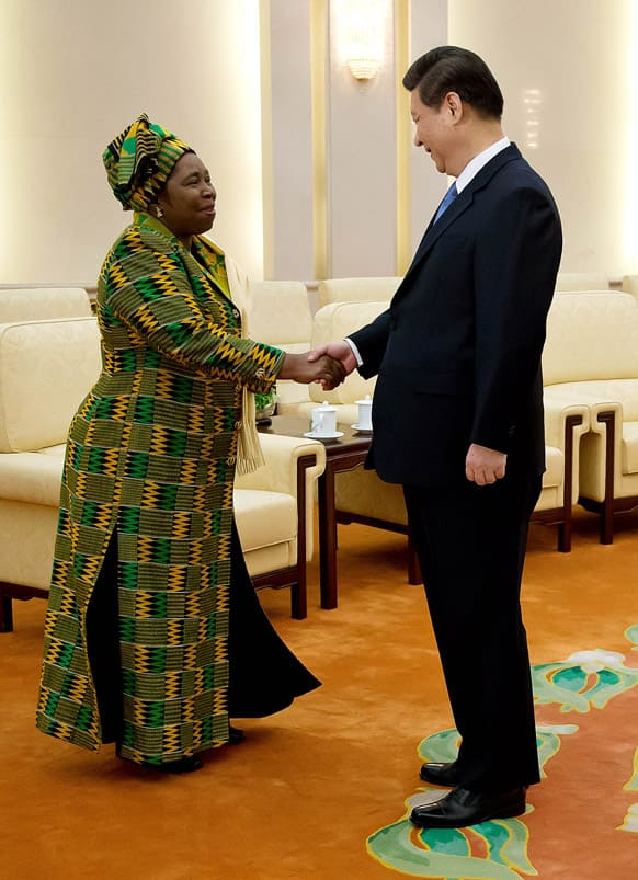 African Union chairperson Nkosazana Dlamini-Zuma, left, is greeted by Chinese Communist Party Secretary General and the country`s new leader Xi Jinping during a meeting at the Great Hall of the People in Beijing.
