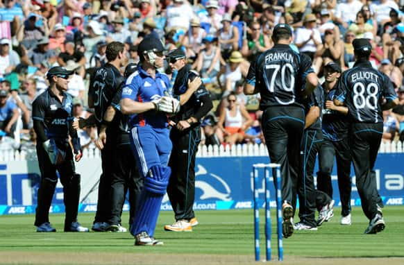 England`s Eion Morgan walks as New Zealand celebrate his dismissal for 1 during their first one day international cricket match at Seddon Park, in Hamilton, New Zealand.