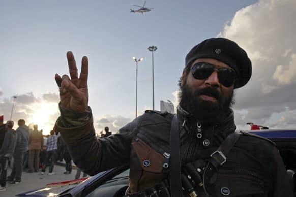 A Libyan rebel gives the victory sign during a celebration to commemorate the second anniversary of the revolution that ousted Moammar Gadhafi, in Benghazi, Libya.