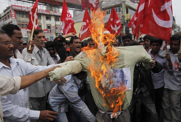 Activists of Communist Party of India (Marxist) burn an effigy representing the United Progressive Alliance (UPA) government during a protest against fuel price hike in Hyderabad.