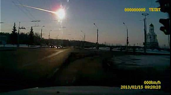 A meteor streaks through the sky over Chelyabinsk, about 1500 kilometers east of Moscow. With a blinding flash and a booming shock wave, the meteor blazed across the western Siberian sky Friday and exploded with the force of 20 atomic bombs.