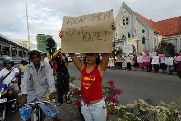 An activist holds a placard during a demonstration to mark