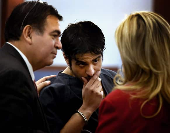Mazen Alotaib confers with his attorney Don Chairez, left, and court interpreter Theresa Tordjman during his arraignment in District Court.  Alotaib, a Royal Saudi Air Force sergeant, pleaded not guilty in the rape of a 13-year-old boy.