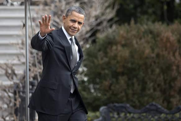 President Barack Obama waves as he leaves the White House in Washington, for Arden, N.C, and the Linamar Corporation to discuss proposals, unveiled in his State of the Union speech, that focus on strengthening the economy for the middle class.