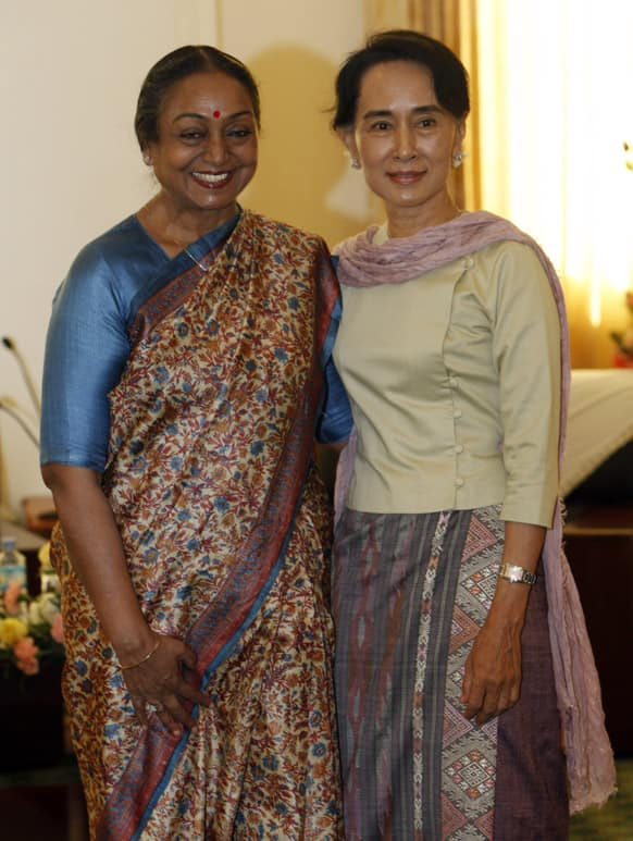 Myanmar opposition leader Aung San Suu Kyi poses for photo along with Indian parliamentary delegation leader Honourable Smt. Meira Kumar during their meeting at parliament building in Naypyitaw, Myanmar.