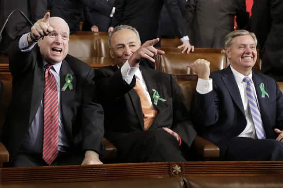 From left, Sen. John McCain, R-Ariz., Sen. Charles Schumer, D-N.Y. and Sen. Lindsey Graham, R-S.C. sit on Capitol Hill in Washington, before President Barack Obama`s State of the Union address during a joint session of Congress.