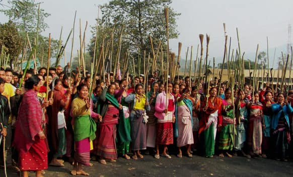 Members of the Rabha tribe stand with sticks and brooms block a road protesting a local government election in Goalpara district, 120 kilometers (75 miles) from Gauhati.