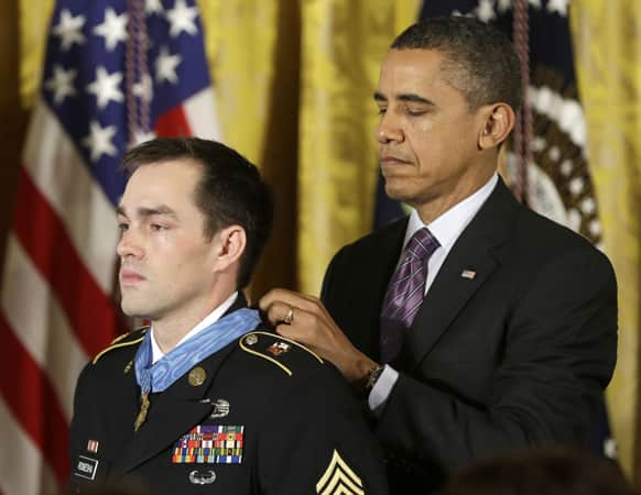 President Barack Obama bestows the Medal of Honor on retired Staff Sgt. Clinton Romesha for conspicuous gallantry,in the East Room of the White House.