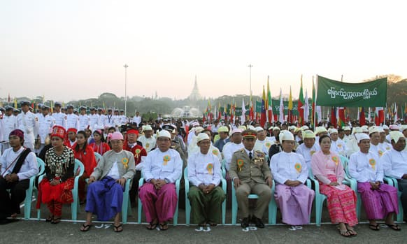 Myanmar officials and representatives of national races attend a ceremony to mark the country`s 66th Union Day in Yangon, Myanmar.