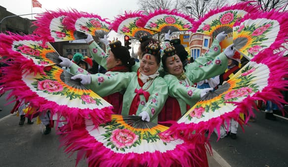 Korean women perform during the traditional Rose Monday carnival parade in Duesseldorf, Germany.