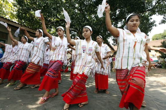 Clad in Karen traditional costumes, members of National Unity party perform traditional Done-Yain dance during a ceremony to mark the Union Day at the party`s headquarters, in Yangon, Myanmar.