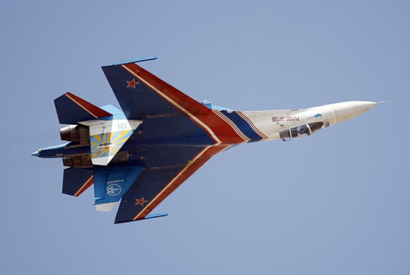 Russian air force air demonstration team, Russian Knights` Sukhoi Su-27 displays an inverted flight during the last day of the Aero India 2013 at Yelahanka air base in Bangalore.